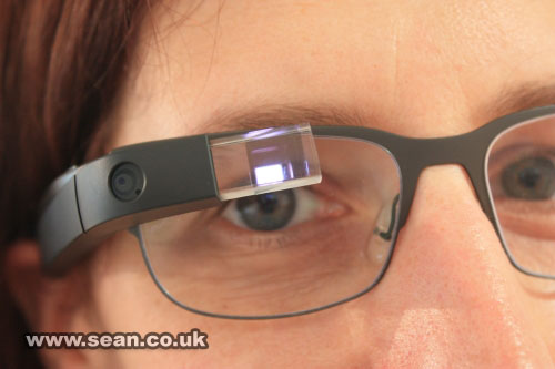 A close-up of a Google Glass in use