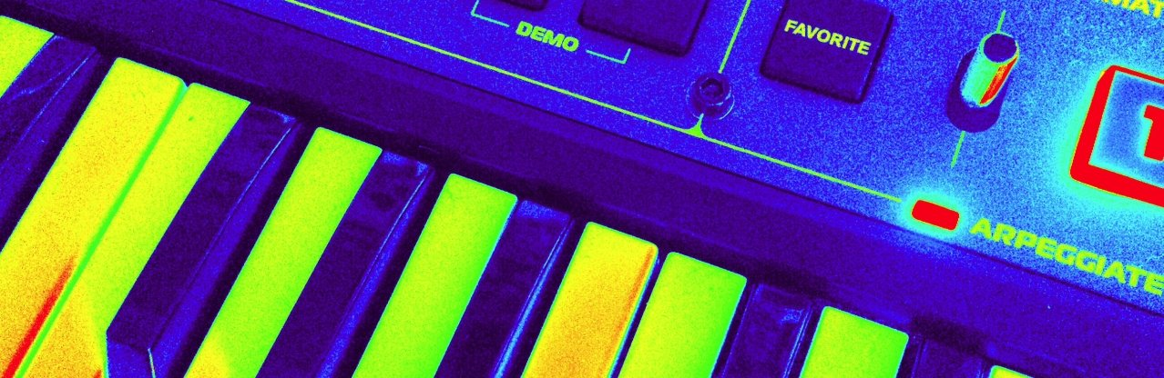 Photo of one of my keyboards with a filter to make the keys bright green and dark blue
