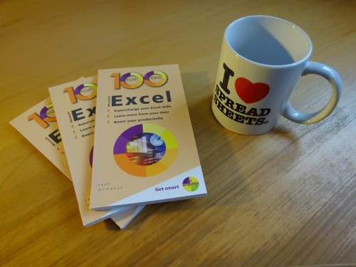 Photo of 100 Top Tips: Microsoft Excel, together with an 'I heart spreadsheets' mug