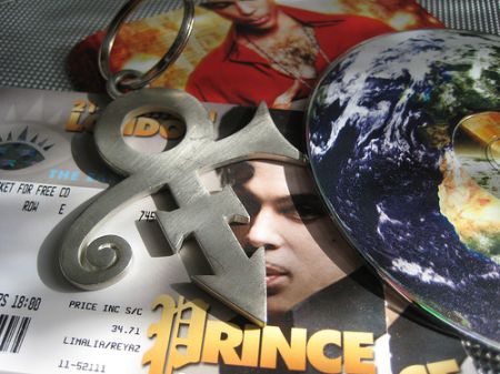 collage of Prince ticket, keyring and Planet Earth CD
